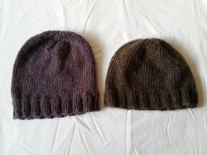 My new Nuzzle hat is the one on the left. The ribbed section looks uneven in this photo, but I promise it isn't. Must. Improve. Photography. Skills.