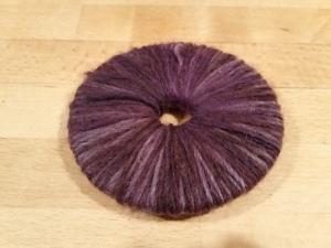 Using the time-honoured pompom-making method.