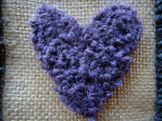 My first rug hooked heart.